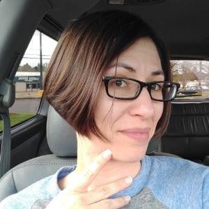 Woman with bob haircut and glasses